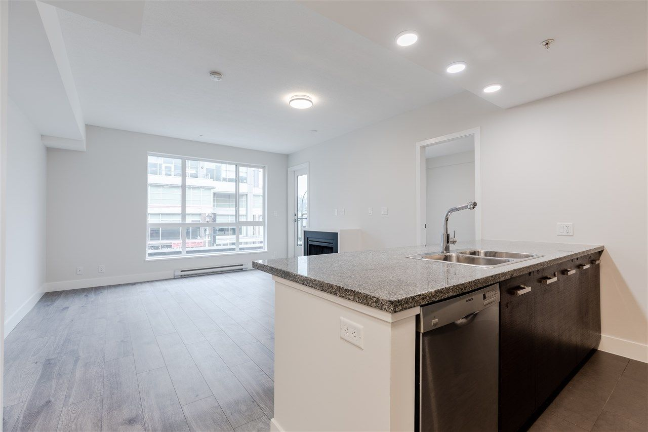 """Main Photo: 207 2957 GLEN Drive in Coquitlam: North Coquitlam Condo for sale in """"The Residences At The Parc"""" : MLS®# R2557542"""