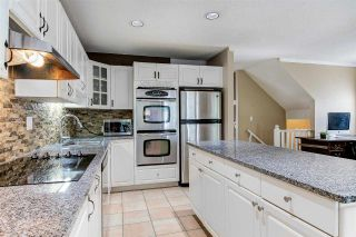 """Photo 2: 128 2998 ROBSON Drive in Coquitlam: Westwood Plateau Townhouse for sale in """"Foxrun"""" : MLS®# R2551849"""