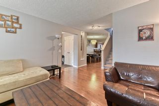 Photo 9: 203 River Heights Green: Cochrane Detached for sale : MLS®# A1145200