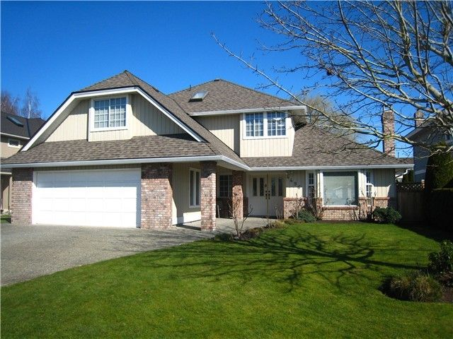 Exterior Front: Meticulously maintained wood siding, new roof covered entrance and oversized driveway