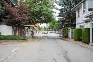 """Photo 1: 107 13895 102 Avenue in Surrey: Whalley Townhouse for sale in """"WHYDHAM ESTATES"""" (North Surrey)  : MLS®# R2610519"""