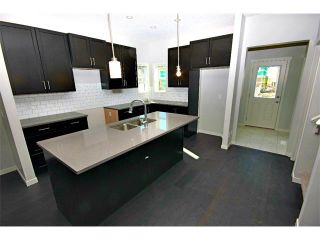 Photo 7: 232 COPPERPOND Parade SE in Calgary: Copperfield House for sale : MLS®# C4002582