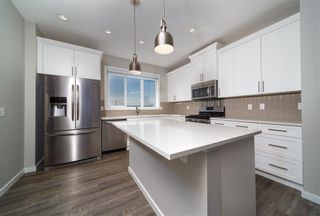 Photo 5: 8 HERITAGE Boulevard: Cochrane Detached for sale : MLS®# C4203081