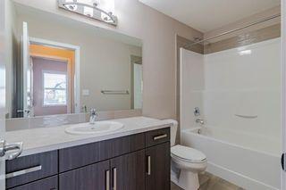 Photo 25: 204 200 Cranfield Common SE in Calgary: Cranston Apartment for sale : MLS®# A1083464