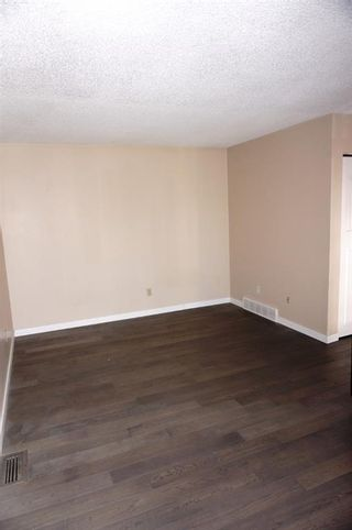Photo 3: A 1215 44 Street SE in Calgary: Forest Lawn Row/Townhouse for sale : MLS®# A1116563