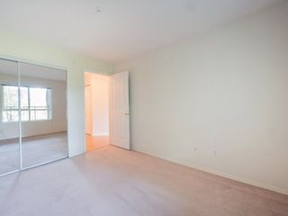 "Photo 14: 220 13880 70 Avenue in Surrey: East Newton Condo for sale in ""Chelsea Gardens"" : MLS®# R2288215"