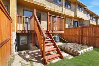 Photo 18: 1433 Ranchlands Road NW in Calgary: Ranchlands Row/Townhouse for sale : MLS®# A1128096