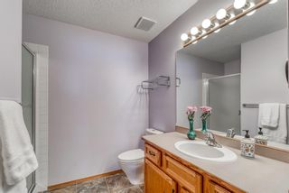 Photo 17: 210 Arbour Cliff Close NW in Calgary: Arbour Lake Semi Detached for sale : MLS®# A1086025