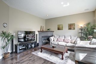 Photo 10: 47 ASPENSHIRE Drive SW in Calgary: Aspen Woods Detached for sale : MLS®# A1106772