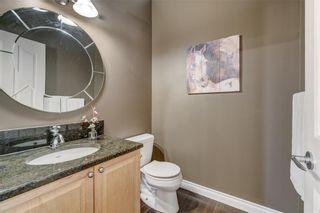 Photo 26: 204 SUNTERRA Boulevard: Cochrane House for sale : MLS®# C4164735