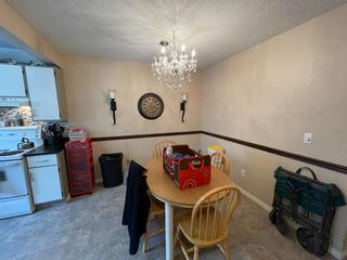 Photo 3: 10 1706 22 Avenue: Didsbury Row/Townhouse for sale : MLS®# A1110698