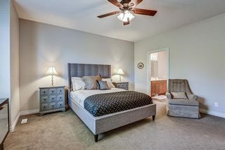 Photo 26: 7 ELYSIAN Crescent SW in Calgary: Springbank Hill Semi Detached for sale : MLS®# A1104538