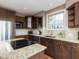 Photo 11: 40 ROSSDALE Road SW in Calgary: Rosscarrock Semi Detached for sale : MLS®# A1046518