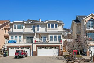 Photo 1: 8412 Silver Springs Road NW in Calgary: Silver Springs Semi Detached for sale : MLS®# A1087527