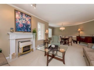 """Photo 4: 208 5375 205 Street in Langley: Langley City Condo for sale in """"GLENMONT PARK"""" : MLS®# R2295267"""