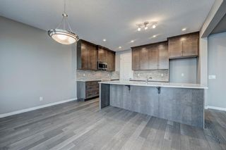 Photo 11: 102 Yorkstone Way SW in Calgary: Yorkville Detached for sale : MLS®# A1055580