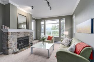 "Photo 2: 404 3001 TERRAVISTA Place in Port Moody: Port Moody Centre Condo for sale in ""NAKISKA"" : MLS®# R2096996"