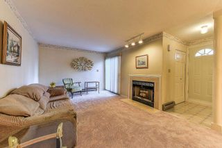 """Photo 3: 105 10091 156 Street in Surrey: Guildford Townhouse for sale in """"Guildford Park"""" (North Surrey)  : MLS®# R2321879"""