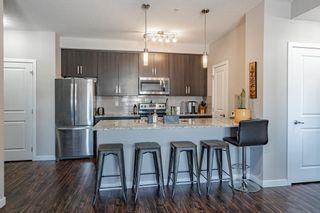 Photo 8: 221 200 Cranfield Common SE in Calgary: Cranston Apartment for sale : MLS®# A1083397