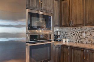 Photo 17: 40 Cougar Ridge Landing SW in Calgary: Cougar Ridge Row/Townhouse for sale : MLS®# A1148928