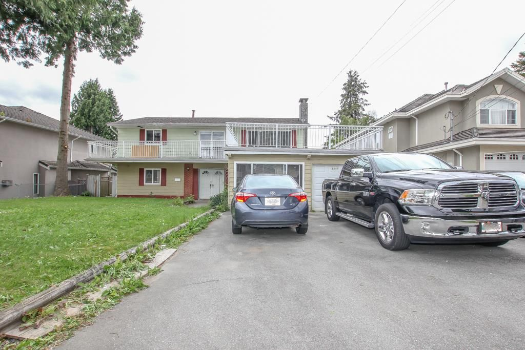 Main Photo: 12341 95A Avenue in Surrey: Queen Mary Park Surrey House for sale : MLS®# R2457932