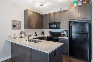 Photo 10: 205 Jumping Pound Common: Cochrane Row/Townhouse for sale : MLS®# A1138561