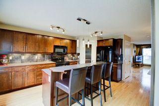 Photo 6: 232 Silverado Range Close SW in Calgary: Silverado Detached for sale : MLS®# A1047985