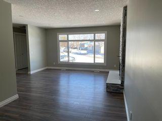 Photo 4: 127 MADDOCK Way NE in Calgary: Marlborough Park Detached for sale : MLS®# A1088803