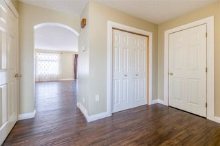 Photo 3: 23 TUSCARORA WY NW in Calgary: Tuscany House for sale : MLS®# C4174470
