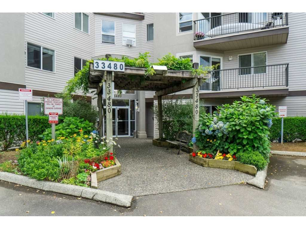 "Main Photo: 208 33480 GEORGE FERGUSON Way in Abbotsford: Central Abbotsford Condo for sale in ""CARMONDY RIDGE"" : MLS®# R2392370"