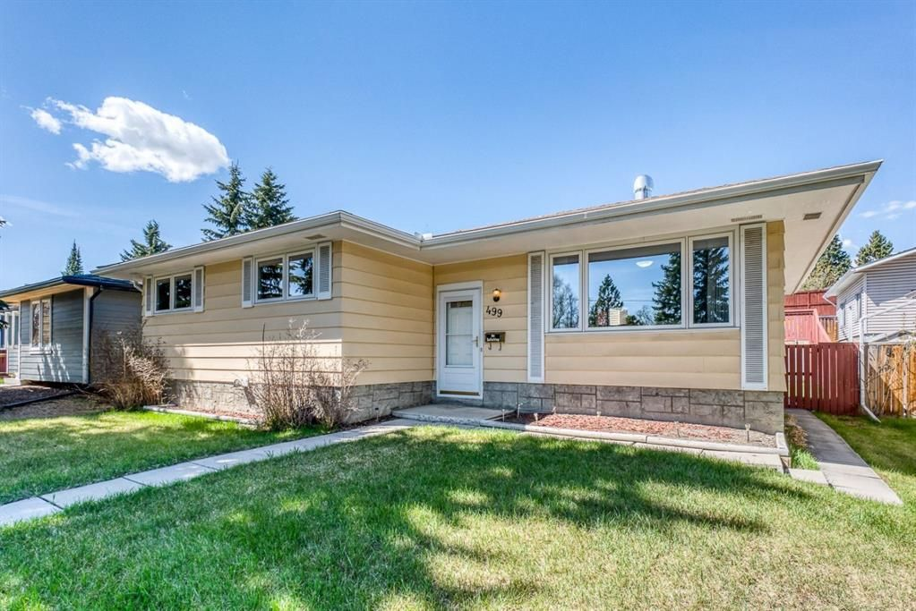 Photo 1: Photos: 499 Canterbury Drive SW in Calgary: Canyon Meadows Detached for sale : MLS®# A1107365