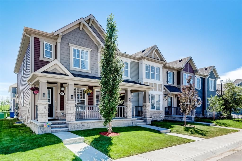 Gorgeous end unit with lovely front and side yard