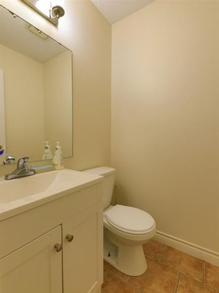 Photo 14: 1512 Ranchlands Road NW in Calgary: Ranchlands Row/Townhouse for sale : MLS®# A1112444