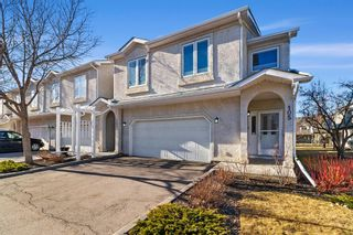 Main Photo: 105 Sunlake Gardens SE in Calgary: Sundance Row/Townhouse for sale : MLS®# A1095497