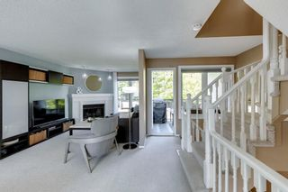 Photo 13: 81 Coachway Gardens SW in Calgary: Coach Hill Row/Townhouse for sale : MLS®# A1147900