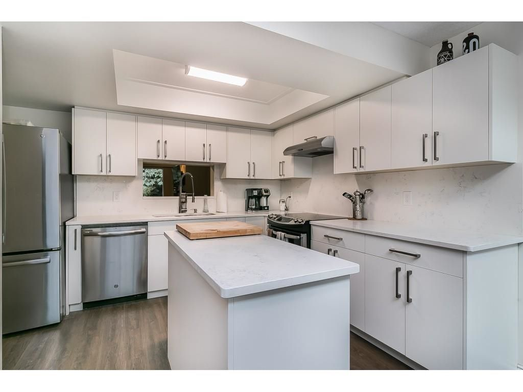 """Main Photo: 8204 FOREST GROVE Drive in Burnaby: Forest Hills BN Townhouse for sale in """"HENLEY ESTATES"""" (Burnaby North)  : MLS®# R2621555"""