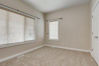 Photo 11: 4111 Garrison Boulevard SW in Calgary: Garrison Woods Row/Townhouse for sale : MLS®# A1108505