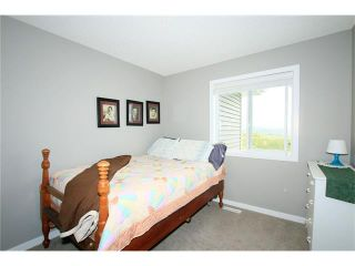 Photo 30: 510 RIVER HEIGHTS Crescent: Cochrane House for sale : MLS®# C4074491