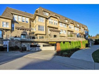 "Photo 1: 203 2110 ROWLAND Street in Port Coquitlam: Central Pt Coquitlam Townhouse for sale in ""AVIVA ON THE PARK"" : MLS®# V1094259"