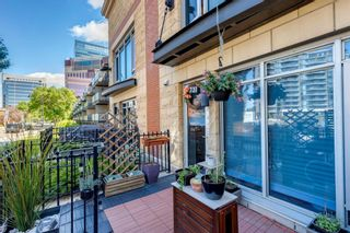Photo 3: 731 2 Avenue SW in Calgary: Eau Claire Row/Townhouse for sale : MLS®# A1124261