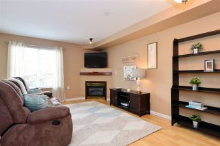 """Photo 2: 103 20200 56 Avenue in Langley: Langley City Condo for sale in """"THE BENTLEY"""" : MLS®# R2142341"""