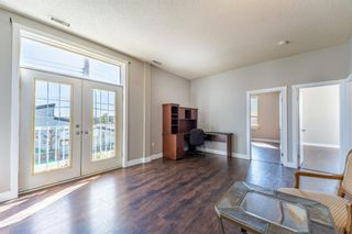 Main Photo: 209 4908 17 Avenue SE in Calgary: Forest Lawn Apartment for sale : MLS®# A1141763