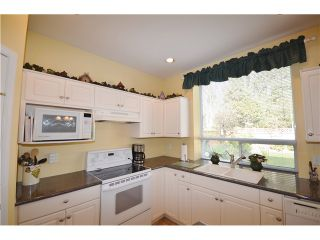 """Photo 8: 1450 RHINE Crescent in Port Coquitlam: Riverwood House for sale in """"RIVERWOOD"""" : MLS®# V1052007"""