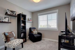Photo 23: 15 West Coach Manor SW in Calgary: West Springs Row/Townhouse for sale : MLS®# A1100327