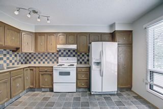 Photo 9: 5 3302 50 Street NW in Calgary: Varsity Row/Townhouse for sale : MLS®# A1147127