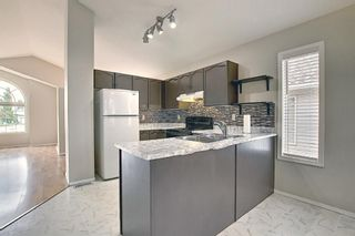 Photo 3: 110 Coverton Close NE in Calgary: Coventry Hills Detached for sale : MLS®# A1119114