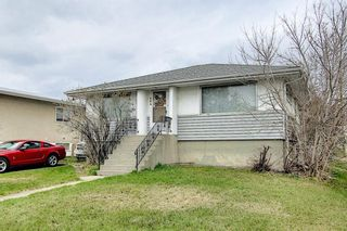 Main Photo: 404 54 Avenue SW in Calgary: Windsor Park Detached for sale : MLS®# A1098373