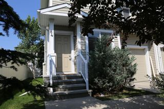 Photo 2: 84 BRIDLERIDGE Manor SW in Calgary: Bridlewood Row/Townhouse for sale : MLS®# A1029938