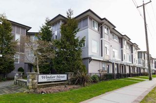 """Photo 1: 32 1010 EWEN Avenue in New Westminster: Queensborough Townhouse for sale in """"WINDSOR MEWS"""" : MLS®# R2343402"""