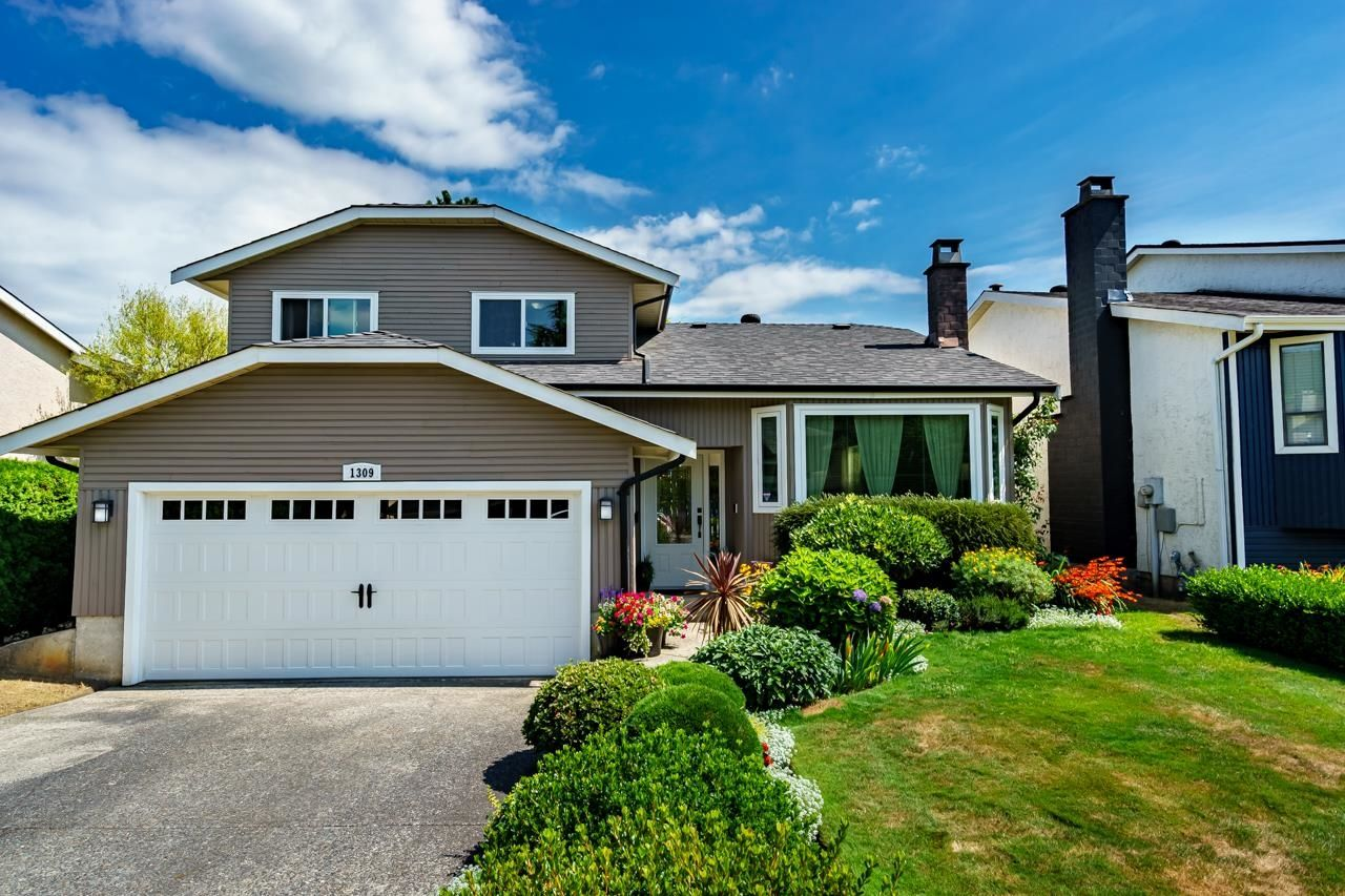 Main Photo: 1309 HORNBY Street in Coquitlam: New Horizons House for sale : MLS®# R2609098